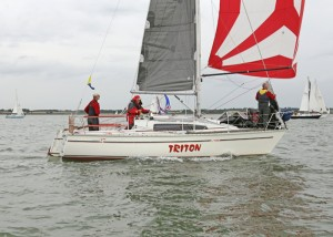 Winner of both classes, 'Triton', with Barry Foulds at the helm, Peter Copsey on the winch, and Bob Appleby on the foredeck - photo by Guy hawkins